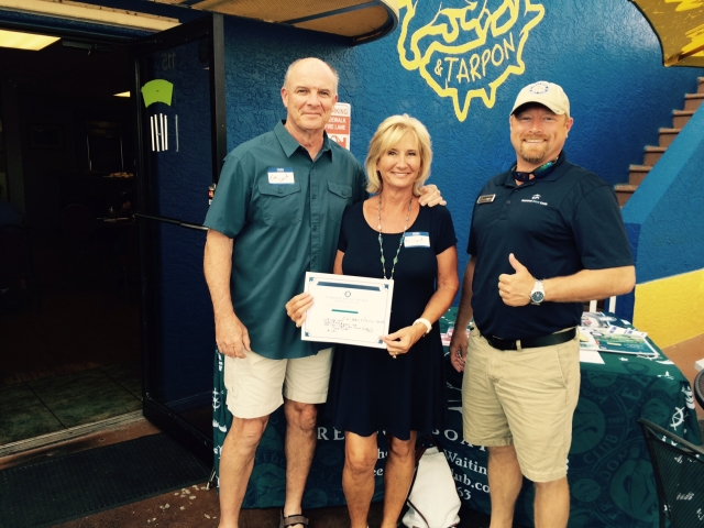 Winners of our Big Brothers Big Sisters raffle at our member social at The Bull and Tarpon