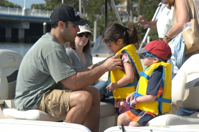 Family preparing for a beautiful day on the water near Naples Freedom Boat Club