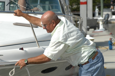 FBC Dockmaster helping members depart for a beautiful day on the water near Naples Freedom Boat Club